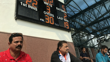 Dinesh Lad (left) watches his son Siddhesh bat for Mumbai