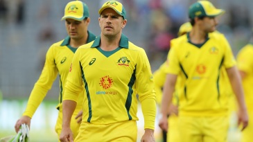 Aaron Finch walks off the field