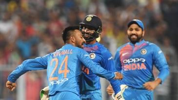 Krunal Pandya celebrates his first international wicket with Dinesh Karthik