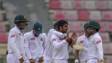 Mehidy Hasan celebrates a wicket with his team-mates
