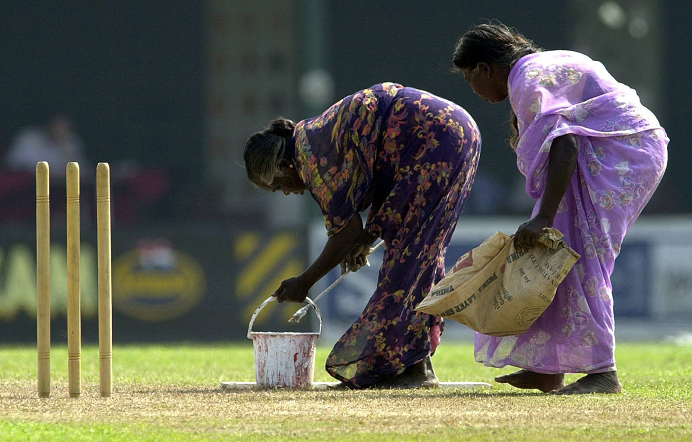 Earth mothers: Female ground staff tend the pitch at the P Sara Oval