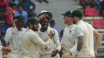 Brandon Mavuta celebrates a wicket with his teammates