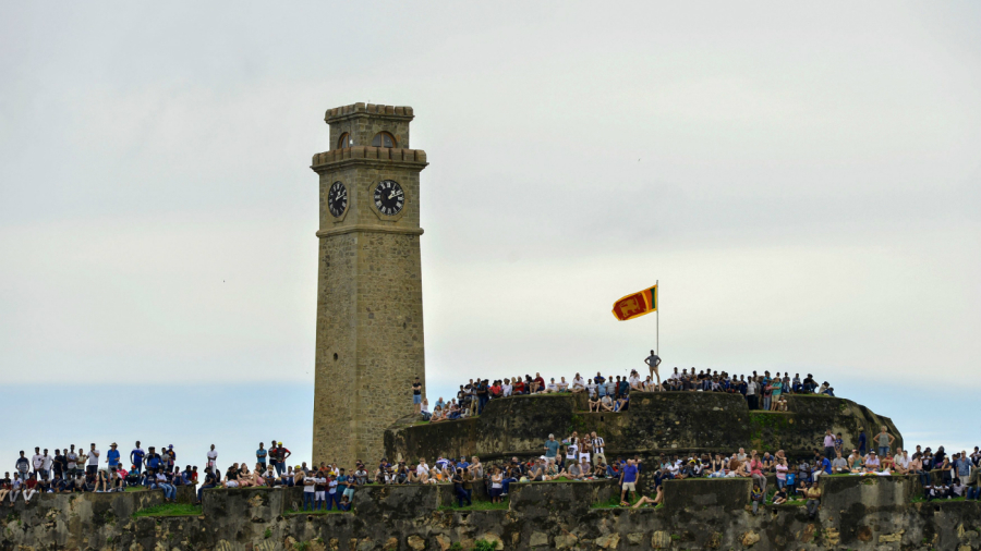 Fans gather by the old fort to watch the 1st Test