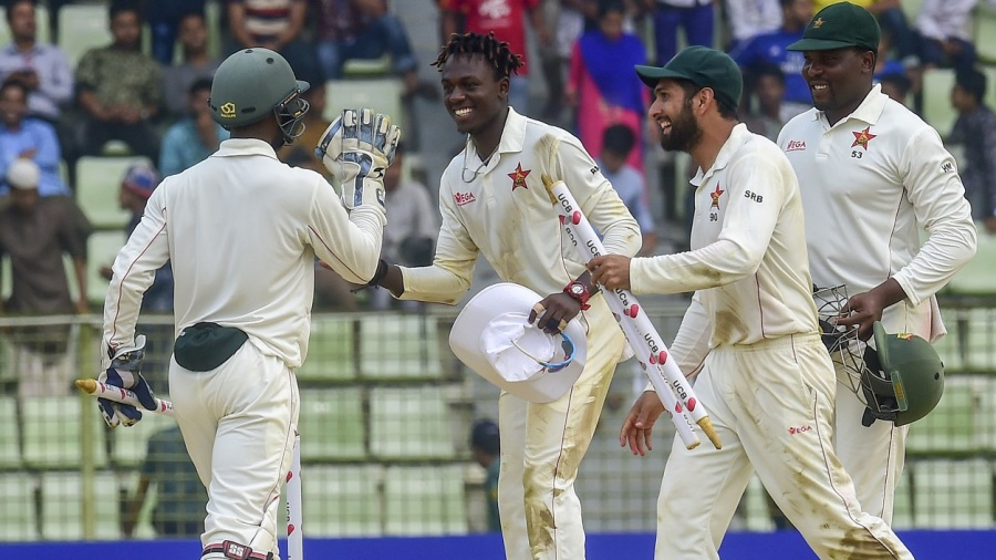 Brandon Mavuta, Sikandar Raza and Hamilton Masakadza are all smiles following Zimbabwe's first overseas Test win in 17 years