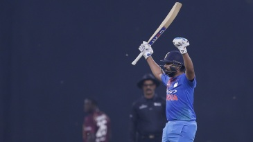 Rohit Sharma salutes the crowd after scoring a century