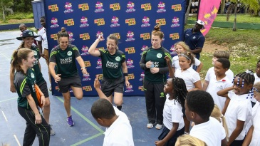 Ireland's players attend a community outreach programme in the Caribbean