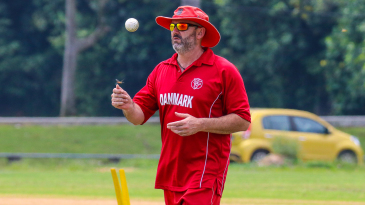 Denmark coach Jeremy Bray flicks a ball in the air as he gets set to begin warmups