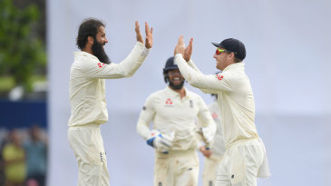 Moeen Ali and Jos Buttler celebrate the fall of Angelo Mathews