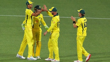 Mitchell Starc, Alex Carey, Chris Lynn and Adam Zampa celebrate Australia's win