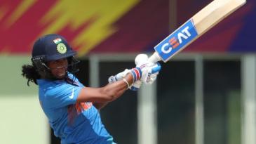 Harmanpreet Kaur goes for the big one