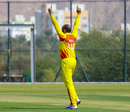 Irfan Afridi breaks out the Starfish celebration pose after another wicket, Denmark v Uganda, ICC World Cricket League Division Three, Al Amerat, November 9, 2018