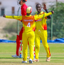 Charles Waiswa gets some love from Henry Ssenyondo after wiping out the tail with 4 for 25, Denmark v Uganda, ICC World Cricket League Division Three, Al Amerat, November 9, 2018