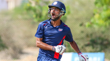 Monank Patel lets out a roar after bringing up his century