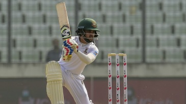 Mominul Haque drives through the covers