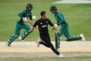 Trent Boult chases the ball in his follow-through as Mohammad Hafeez and Fakhar Zaman steal a quick single, Pakistan v New Zealand, 3rd ODI, Dubai, November 11, 2018