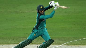 Shoaib Malik leans into a cover drive