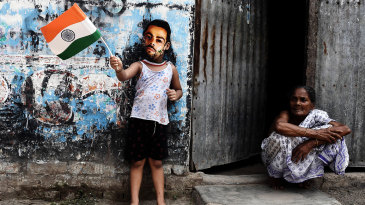 A child wears a Virat Kohli mask and waves an India flag, Kolkata, June 18, 2017