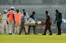 Tendai Chatara is stretchered off after picking up a leg injury, Bangladesh v Zimbabwe, 2nd Test, Mirpur, 2nd day, November 12, 2018