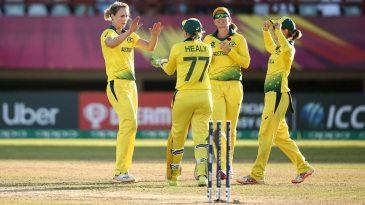 Ellyse Perry celebrates a wicket with her teammates