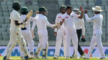 Taijul Islam celebrates a wicket with team-mates