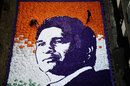 Artists complete a portrait of Sachin Tendulkar made with pieces of paper for his 45th birthday, Mumbai, April 24, 2018
