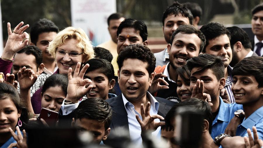 Sachin Tendulkar poses for a photo with children