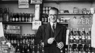 Harold Larwood behind the counter of his sweet shop