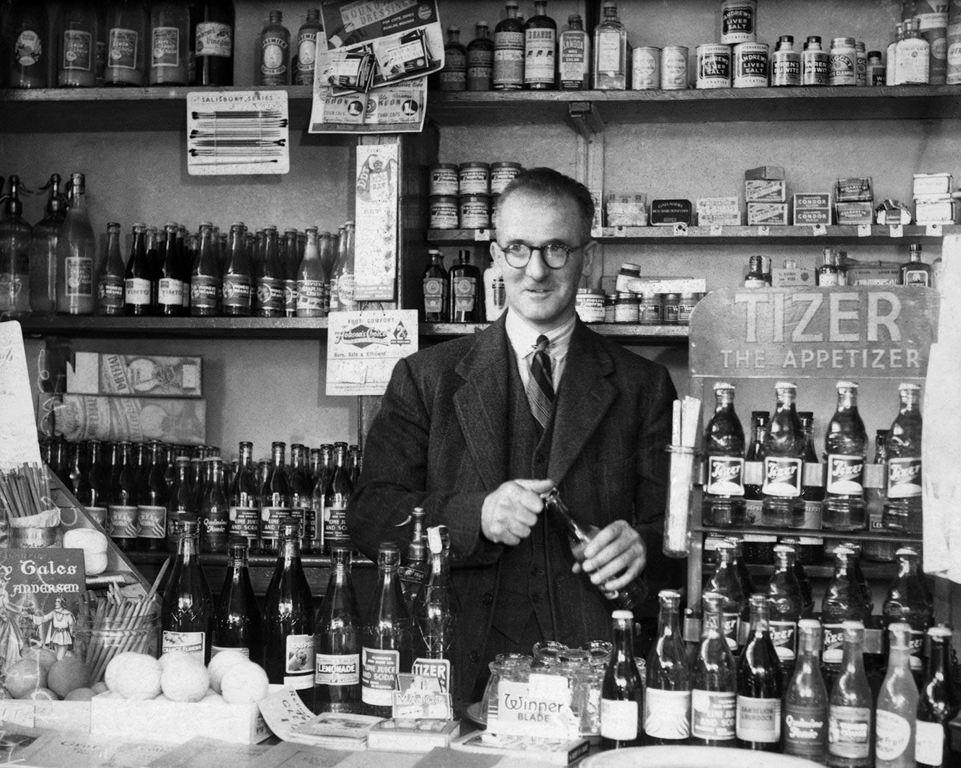 Harold Larwood behind the counter of his sweet shop