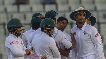 Taijul Islam mobbed by his teammates after completing a five-for