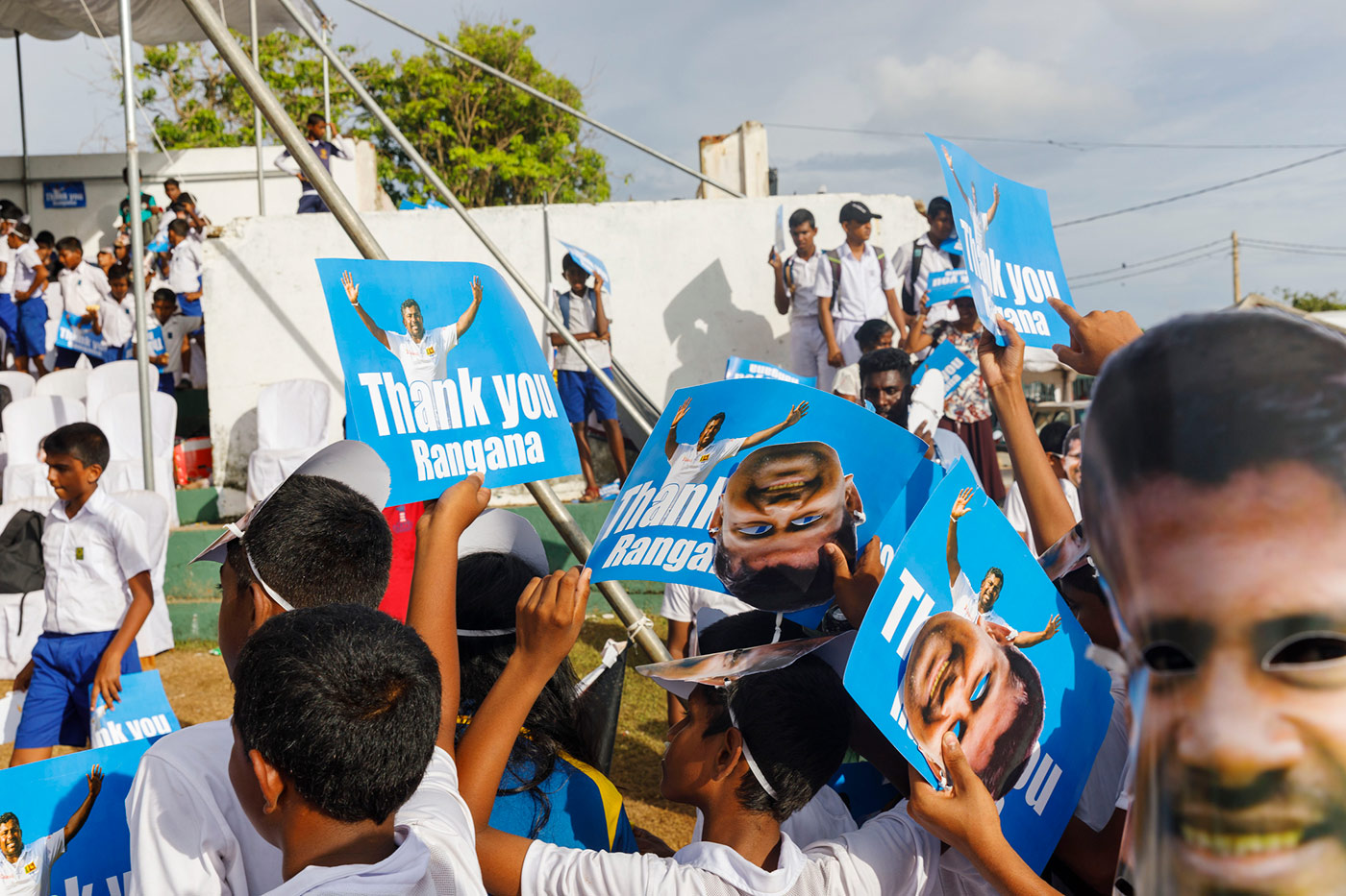 Herath's army: schoolkids cheer for the Sri Lankan champion bowler