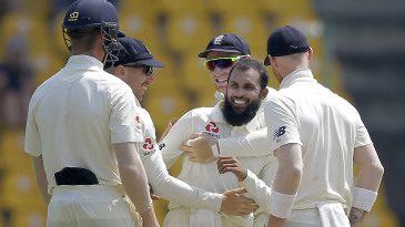 Adil Rashid is congratulated by his team-mates