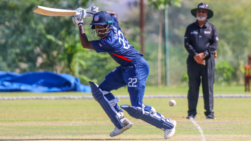 Hayden Walsh Jr glides a single through point to bring up his maiden half-century for USA