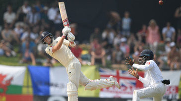 Joe Root skips down to hit through the leg side