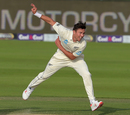 Trent Boult in his follow-through, Pakistan v New Zealand, 1st Test, Abu Dhabi, 1st day