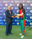 Nelson Odhiambo receives the Man of the Match award for his 80 off 58 balls, Kenya v Singapore, ICC World Cricket League Division Three, Al Amerat, November 16, 2018