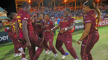 The West Indies players celebrate their win with a dance