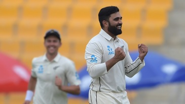 Ajaz Patel celebrates his maiden Test wicket