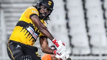 Chris Gayle goes after the ball
