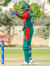 Alex Obanda turns his bat into a mock sniper rifle to celebrate a half-century, Denmark v Kenya, ICC World Cricket League Division Three, Al Amerat, November 18, 2018