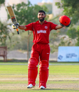 Captain Hamid Shah raises his bat after reaching a century, Denmark v Kenya, ICC World Cricket League Division Three, Al Amerat, November 18, 2018