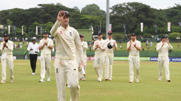 Jack Leach leads England from the field after his five-wicket haul at Pallekele
