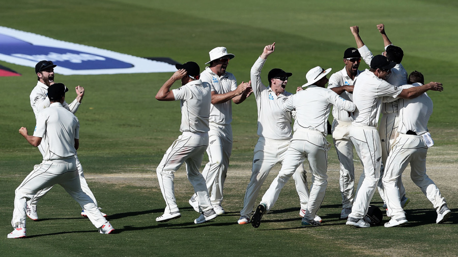 The New Zealand players celebrate victory