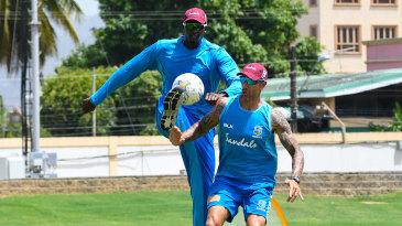 Nic Pothas plays football with Jason Holder