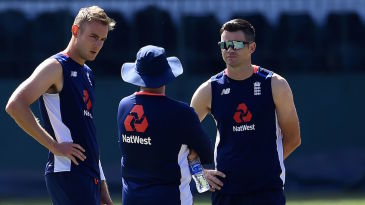 Stuart Broad and James Anderson chat with coach Trevor Bayliss