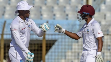 Shimron Hetmyer punches gloves with Shane Dowrich after reaching a half-century