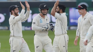 Ajaz Patel and Kane Williamson celebrate a wicket