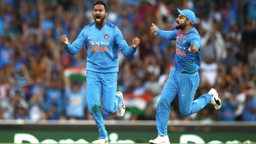 Krunal Pandya and Virat Kohli celebrate Ben McDermott's wicket