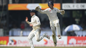 Ben Foakes and Jack Leach celebrate the run-out of Kusal Mendis