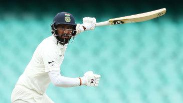 Cheteshwar Pujara takes his bottom hand off the bat as he drives