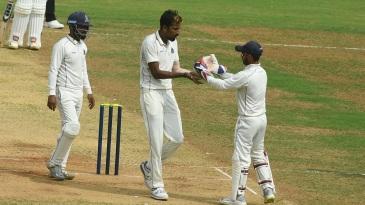 Ishan Porel celebrates a wicket